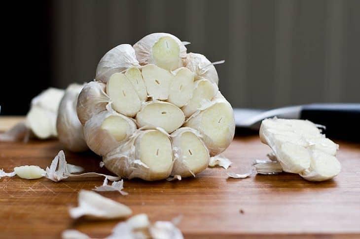 head-of-garlic-halved-skin-stays