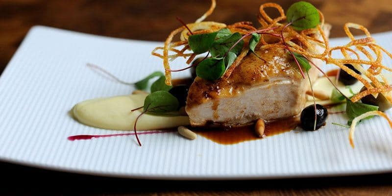 Roast chicken breast, potato puree and pine nuts